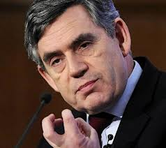 Gordon Brown squeezing an imaginary Tony Blair heart.