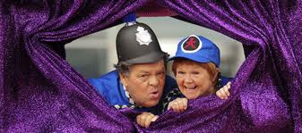 X-rated Krankies: a black helmet pushing through a big purple cunt.